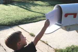 child mailing a letter